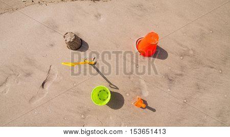 Top view of bucket, spade and sandcastle at Pakiri beach.