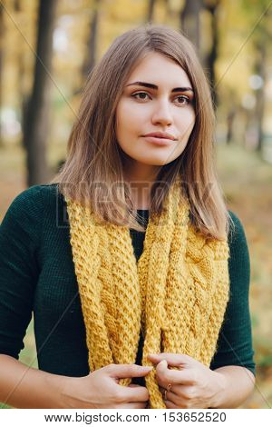 Pretty woman in a yellow knit scarf.