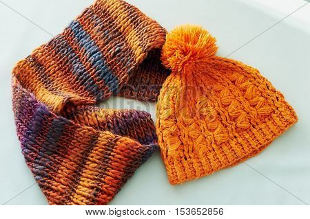 Cozy crochet kit in orange. Scarf and hat with pompom, chunky knit