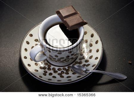 Coffee with chocolate. Dark background.