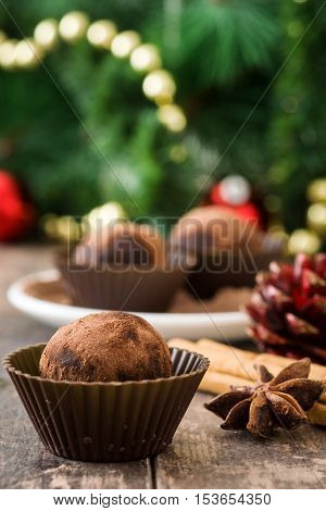 Delicious christmas chocolate truffles on wooden table