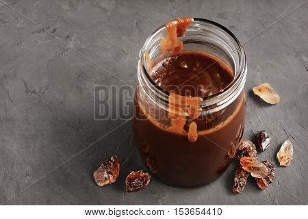 Homemade Caramel In Glass Jar And Caramelized Sugar