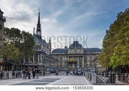 PARIS FRANCE - OCTOBER 11 2015: The Sainte-Chapelle (Holy Chapel) is a royal chapel in the Gothic style within the medieval Palais de la Cite the residence of the Kings of France until the 14th century on the Cite Island in the heart of Paris France