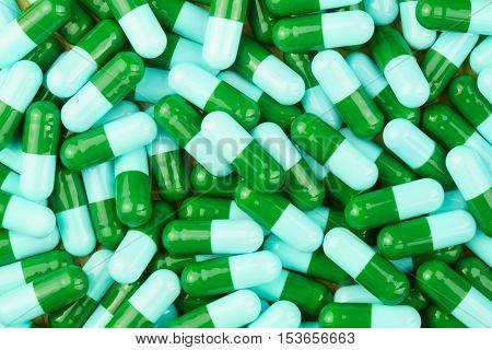 Pile of green and blue antibiotic capsule