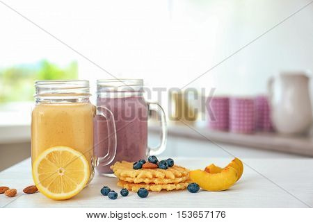 Healthy breakfast with smoothie and wafers on kitchen table