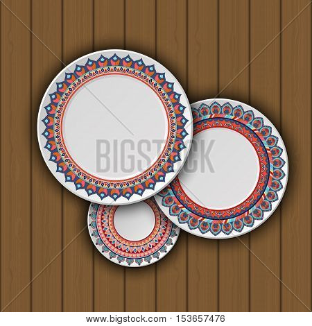 Set of decorative plates with a ethnic tribal ornament of handwork and an empty space in the center. Vector illustration.