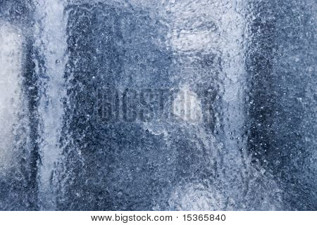 Frozen abstract background. Glass with blue tint.