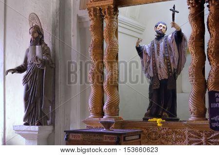 Old Goa India - November 13, 2012: Interior of Basilica of Bom Jesus or Borea Jezuchi Bajilika - Roman Catholic church in Old Goa. The Basilica Church holds the mortal remains of St. Francis Xavier.