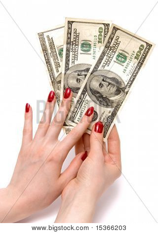 Two woman hands holding dollars. On white with shadows.