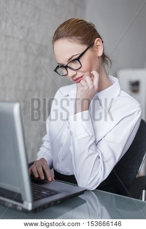 Smart blonde woman online flirt during work time in office
