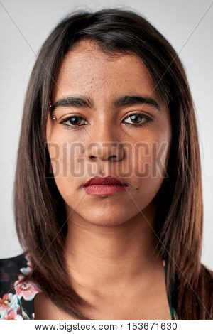 Portrait of real woman with no expression ID or passport photo full collection of diverse face and expressions