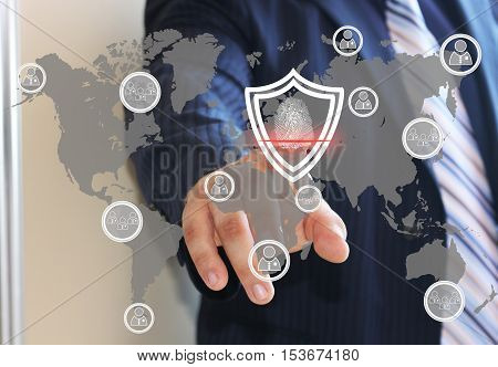 Businessman, button security shield virus icon business online login on the touch screen with the world map.The concept of security included in the global network with a fingerprint scanner.