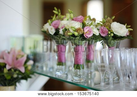 Bridesmaids bouquets prepared for a wedding ceremony