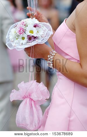 Bridesmaid with bouquet at wedding ceremony in church