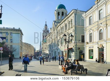MOSCOW - OCTOBER 25: People walking and resting on Nikolskaya street on October 25 2016 in Moscow. Nikolskaya street connects Red Square and Lubyanka Square.