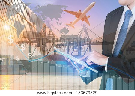 Businessman press digital tablet to show global network partnership connection trade use for logistic export trade background.(Elements of this image furnished by NASA)