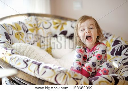 Little Funny Girl In Pajamas On Sunny Morning
