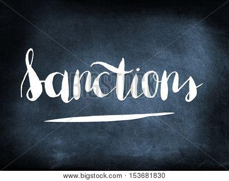 Sanctions handwritten on a chalkboard