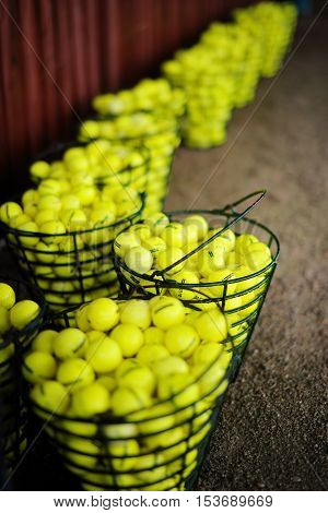Baskets Of Golf Balls On A Golf Field