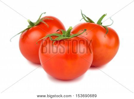 Three red ripe tomatoes on a white background