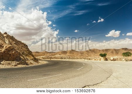 Road passes through rocky Sahara desert, Tunisia. Africa