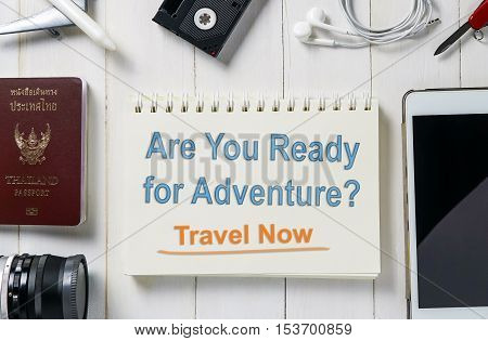 Ready for Adventure travel? Travel and book your ticket and hotel online now. Online Travel agency banner in pastel toning with travel equipments. Travel Online service concept poster.