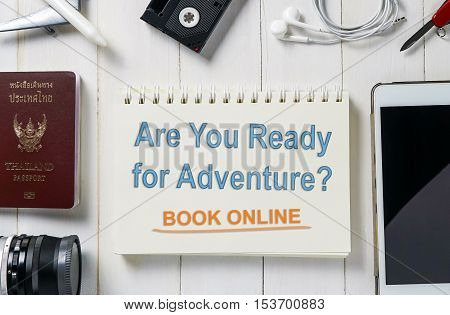 Ready for Adventure travel? book your ticket and hotel online now. Online Travel agency banner in pastel toning with travel equipments. Travel Online service concept poster.
