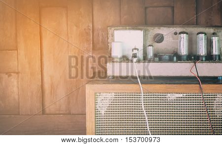 Vintage Vacuum Valve tube amplifier in vintage filter with flair copy space
