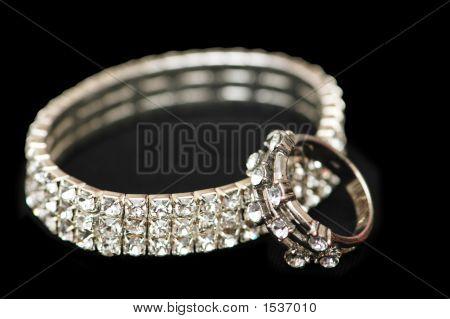 Diamond Bracelet And Ring Isolated On Black
