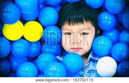 Asian Boy in a Ball pool playground