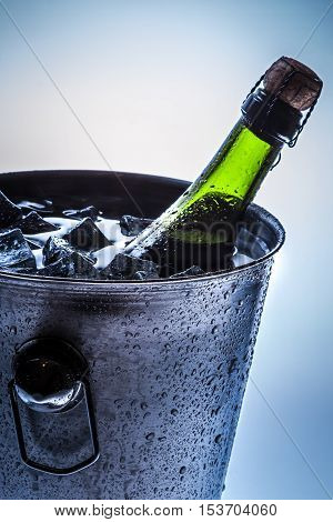 Closeup of ice cold bucket with cold champagne