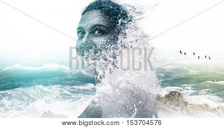 Double exposure portrait of a beautiful attractive woman and wild sea water