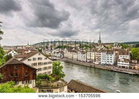 Zurich Switzerland - May 24 2016: Architecture of Zurich. Aerial view of Zurich old town and River Limmat from Lindenhof in Zurich on a cloudy day Switzerland.