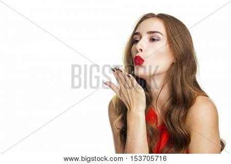Blow kiss, young caucasian female blonde model, isolated on white background