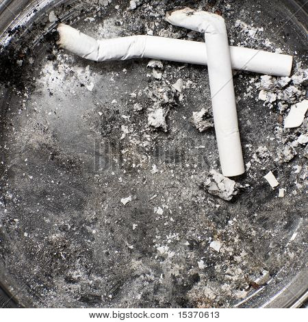 Ash-tray with cigarettes. Black and white concept.