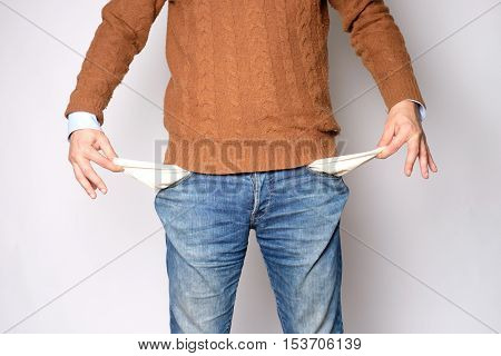 Man Opens His Pockets And There Is No Money