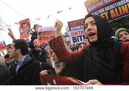 ISTANBUL, TURKEY-JANUARY 28: Unidentified Muslim demonstrators in Turkey assembled in the courtyard of Fatih Mosque to support the Egyptian and Tunisian rebels on January 28, 2011 in Istanbul,Turkey