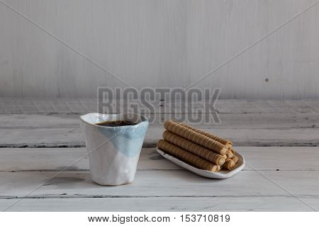 cookies and coffee on a white background white and green ceramic cups ceramic ware on a white background