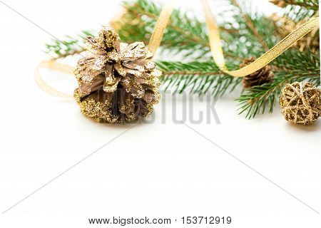 Christmas background. New year's Eve. 2017. tree, gold, cones, ornaments. White space place