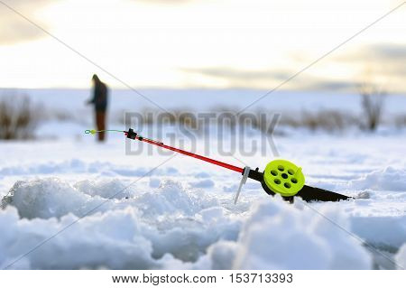 Men's winter fun hike to the pond on the ice-fishing