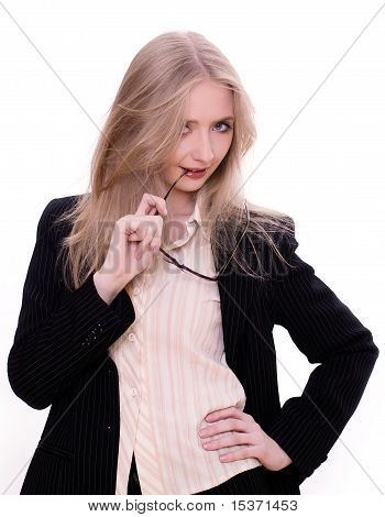 Sexy businesswoman playing with glasses