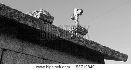 Detail of the of the cross on top of the all the granaries called espigueiros in Northern Portugal
