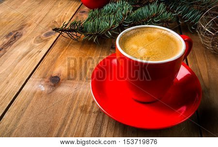 Christmas breakfast, fragrant coffee next to the Christmas tree branches, pine cones and decorations. Copy space