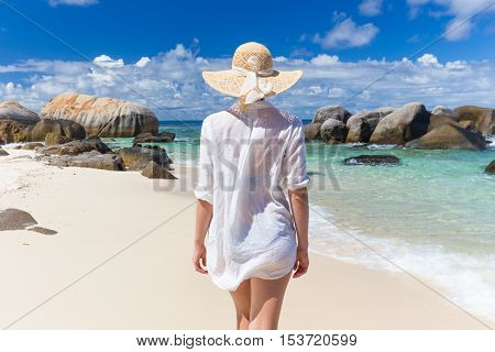 Woman On Summer Vacations On Tropical Beach Of Mahe Island, Seychelles.