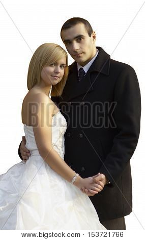 Beautiful wedding couple hold each other hand and embracing under the sunbeam isolated on white.A young couple in love.