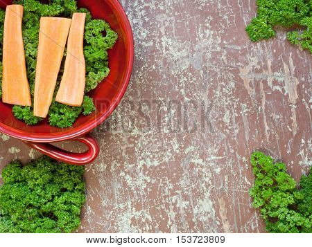 Portion of fresh cutted herbs and carrots in a bowl