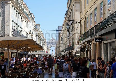 Lisbon, Portugal - July 27, 2016: Rua Augusta with Praca do Comercio (Commerce Square) in Lisbon. Portugal