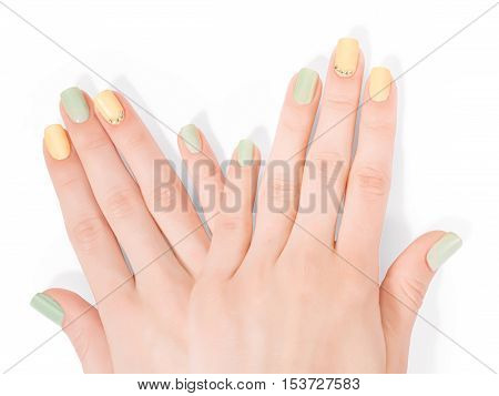 Two woman hands with art shellac manicure and rhinestones. Isolated on white clipping path included