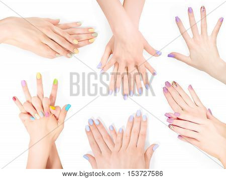 Bundle of hands with creative shellac art manicure. Isolated on white