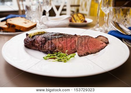 New York steak with herb butter on a plate